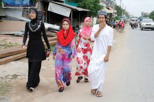 11_A-group-of-young-Cham-Muslims-walk-through-Phnom-Penh's-Russey-Keo-district